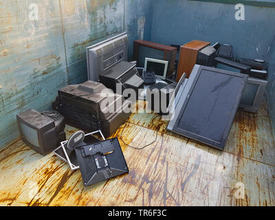 container with damaged TV, Germany - Stock Photo