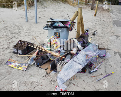 waste of fireworks displays at a garbage trash an the Baltic Sea, Germany, Mecklenburg-Western Pomerania, Ruegen - Stock Photo