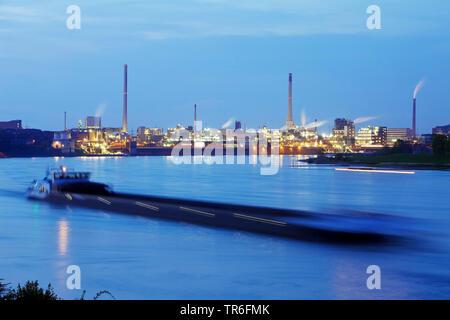 shipping on River Rhine and Chempark in Uerdingen in twilight, Germany, North Rhine-Westphalia, Lower Rhine, Krefeld - Stock Photo