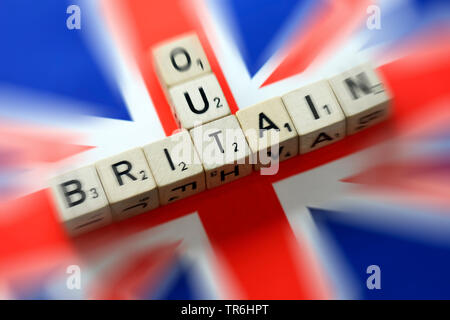the words Out and britain on the flag of Great Britain, symbol picture for brexit, United Kingdom - Stock Photo
