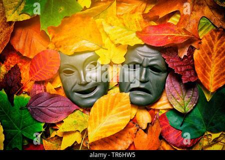 masks among autum leaves, autum blues, Germany - Stock Photo