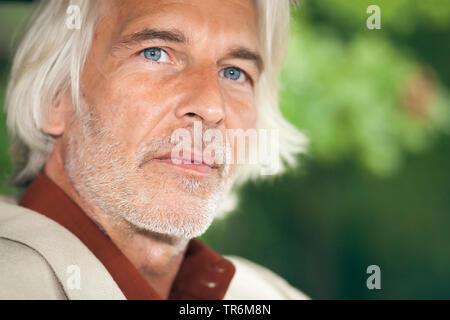 elderly man with grey long hair, Germany - Stock Photo