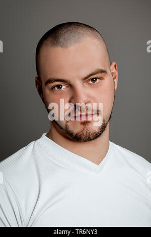 portrait of a young man with bald head and beard, Germany - Stock Photo