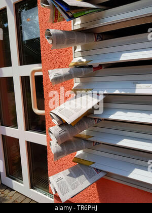 free newspapers in a postbox, Germany - Stock Photo