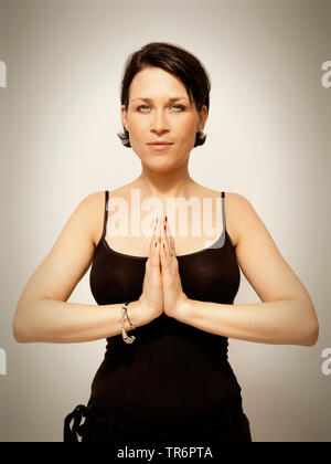 pretty young woman doing a yoga posture, Germany - Stock Photo