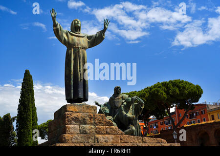 Saint Francis of Assisi statue on the Piazza di Porta San Giovanni, Italy - Stock Photo