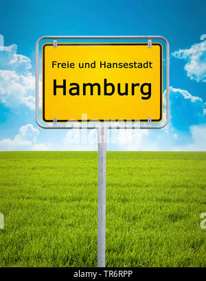 town sign of Hamburg in front of a green meadow, Germany, Hamburg - Stock Photo