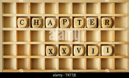wooden game with the word chapter XXVII - Stock Photo