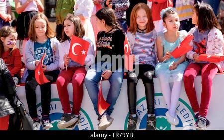 Eskisehir/Turkey-April 23 2019:Turkish girls with Turkish flag enjoy April 23 national sovereignty and children's day (23 Nisan ulusal egemenlik ve ço - Stock Photo