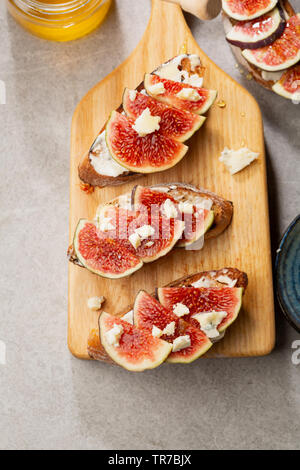 Cheese and figs bruschetta top view - Stock Photo