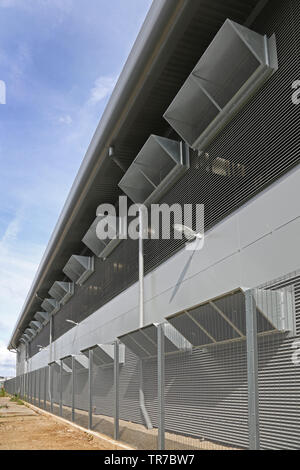 Side view of a secure data storage centre run by Zenium on the Slough Trading Estate, near Heathrow, London, UK - Stock Photo