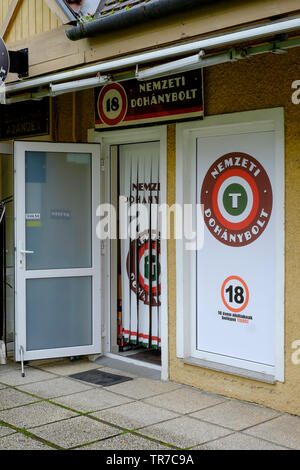 exterior of a hungarian government approved and licensed shop for selling tobacco products zala county hungary - Stock Photo