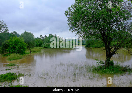 small river overflows after a period of prolonged heavy rain flooding the surrounding fields and meadows zala county hungary - Stock Photo