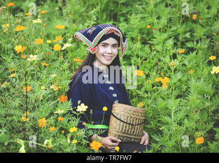 Asia woman thai style dress tribe Tai Dam / Portrait of beautiful young girl smiling traditional costume wearing with fabric woven on head - Woman on - Stock Photo