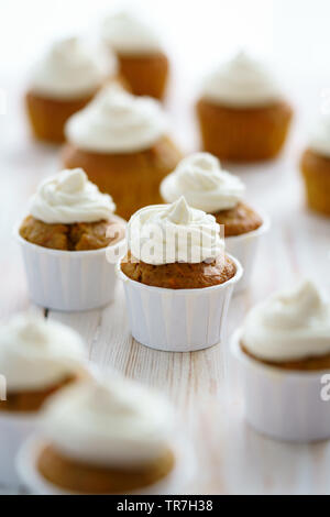Carrot cupcakes with vanilla frosting. White wooden table, high resolution - Stock Photo