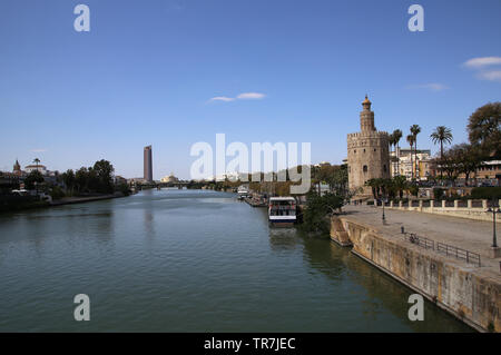 Spain. Andalusia. Seville. Tower of  Gold and Guadalquivir river. - Stock Photo