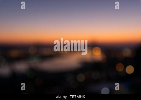 Colorful blurred city lights background. - Stock Photo