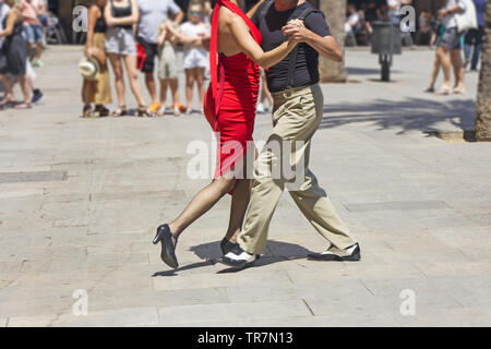 Street couple dancers performing Argentine tango dance - Stock Photo