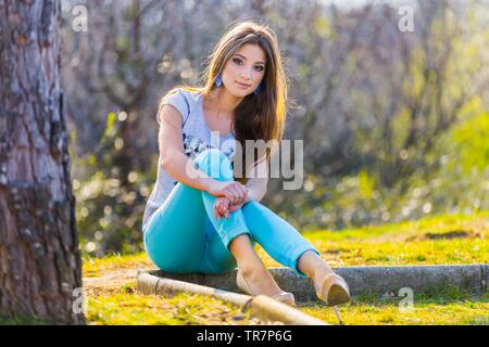 Teen girl legs heels wearing Blue pants looking at camera eye-contact attractive pretty and beautiful female person MR - Stock Photo