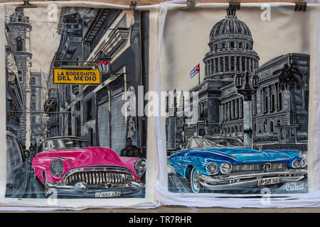 Paintings of classic american cars for sale on a pavement in Habana Vieja (Old Town) Havana, Cuba, Caribbean - Stock Photo