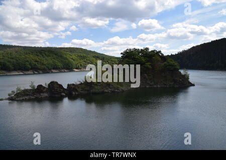 Small green island in middle of lake forest nature landscape hiking travel beauty - Stock Photo