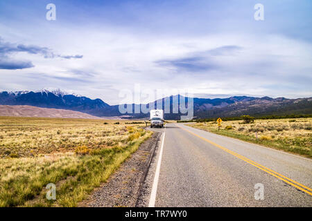 Great Sand Dunes NP, CO, USA - May 5, 2017: The F350 Ford with a trailer parked along the preserved park - Stock Photo