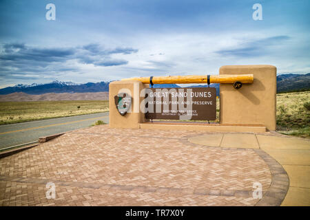 Great Sand Dunes NP, CO, USA - May 5, 2017: A welcoming signboard at the entry point of preserve park - Stock Photo