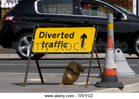 Close up image of a freestanding Diverted Traffic sign with arrow, Dorchester, Dorset, England, UK - Stock Photo