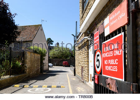 Image of numerous signs on the gate of the Delivery Office in Melksham, Wiltshire, England, UK - Stock Photo