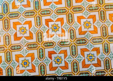 colored azulejo ceramic tiles in yellow, orange and green. - Stock Photo