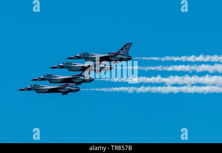 Wantagh, New York, USA - 24 May 2019: The United States Air Force Thunderbirds performing the echelon pass in review on Memorial Day Weekend. - Stock Photo
