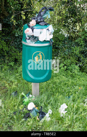 Overflowing litter bins in the countryside, England UK - Stock Photo
