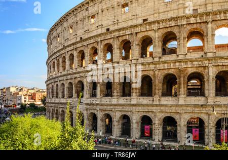 ROME, ITALY 04 OCTOBER  2018 ;Italian spring walks. The spring sun illuminating the coliseum in Rome. - Stock Photo