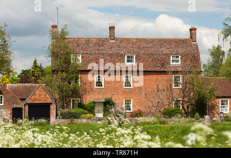A large red brick house in The High Street, Avebury, Wiltshire, England - Stock Photo