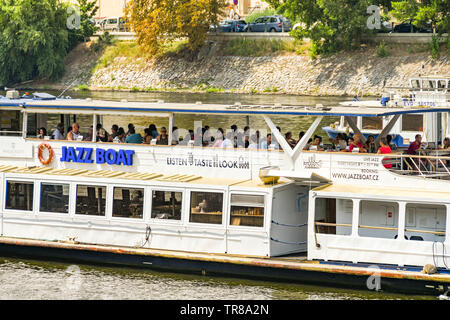 PRAGUE, CZECH REPUBLIC - JULY 2018: The Jazz Boat cruising on the River Vltava in Prague with people on board. - Stock Photo
