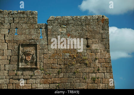 Family coat of arms carved on a wall made of stone bricks at the Sortelha Castle. An astonishing and well preserved medieval hamlet in Portugal. - Stock Photo