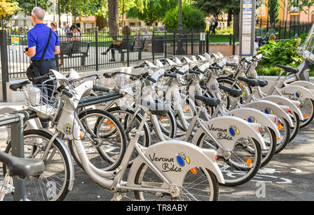 VERONA, ITALY - SEPTEMBER 2018: Bicycles in their docking stations available to rent as part of the Verona Bike scheme. - Stock Photo