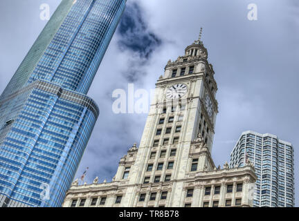 The Wrigley Building clock tower on the Magnificent Mile in Chicago, Illinois USA. - Stock Photo