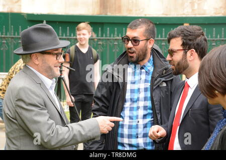 George Galloway in Old Place Yard, Westminster 30th May 2019 some PTM supporters spot George and ask him to speak at their demo. He politely refused. - Stock Photo