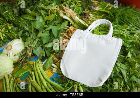 Zero waste use less plastic concept / Fresh vegetables organic and eco cotton fabric bags - white tote canvas cloth bag  in market free plastic shoppi - Stock Photo