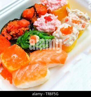 Set box sushi rolls rice and sashimi with salmon tuna royal prawn cheese cream salad seaweed sushi menu style japanese food - Stock Photo