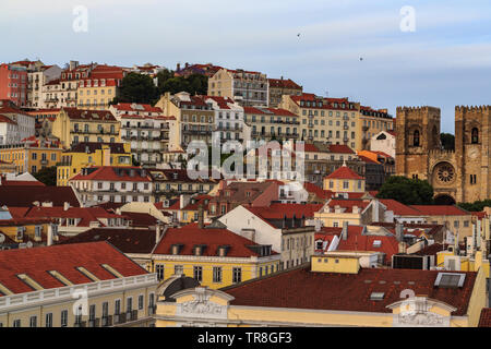 Lisbon hill with typical houses and Lisbon Cathedral ( Sé de Lisboa) - Stock Photo
