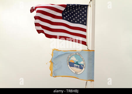 The municipal flag and the U.S. flag flying in Cape Charles, VA, USA