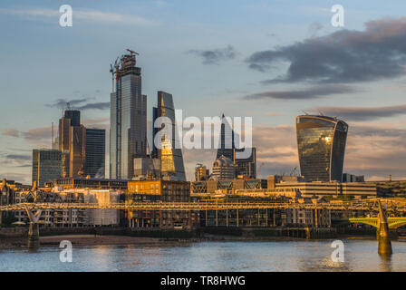 London, United Kingdom - April 17, 2019: London skyscrapers along the River Thames make the city a modern style. - Stock Photo