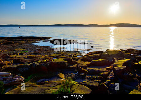 A beautiful sunrise on a rocky beach on Vancouver Island in British Columbia Canada.