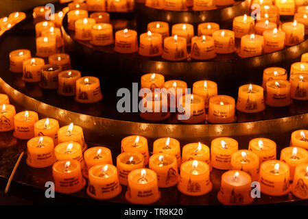 Munich, Germany - November 01, 2018: Candles in St. Peter's Church or Peterskirche in Munich - Stock Photo