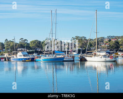 TASMANIA, AUSTRALIA - MARCH 7, 2019: A variety of boats moored in St Helens on the East Coast of Tasmania in Australia. - Stock Photo