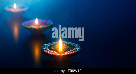 Happy Diwali - Diya oil lamps lit during celebration - Stock Photo