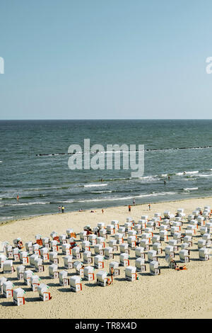 Typical German style beach deckchairs on the Baltic Sea coast of Rugen island northern Germany. - Stock Photo
