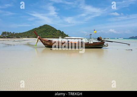 Longtail Boat at Loh Ba Kao Bay on Koh Phi Phi, Thailand - Stock Photo